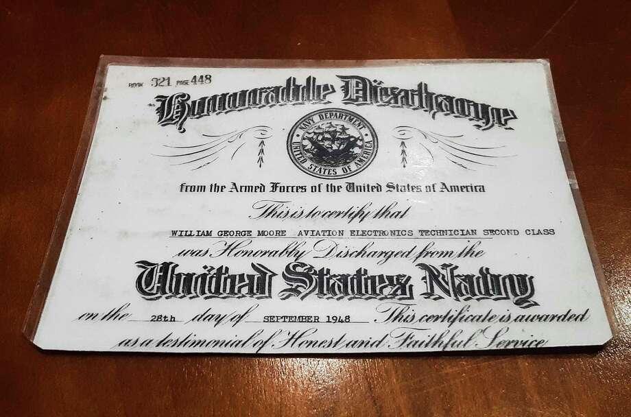 A discharge card from the U.S. Navy belonging to Midland resident Bill Moore, a World War II veteran. (Katy Kildee/kkildee@mdn.net)
