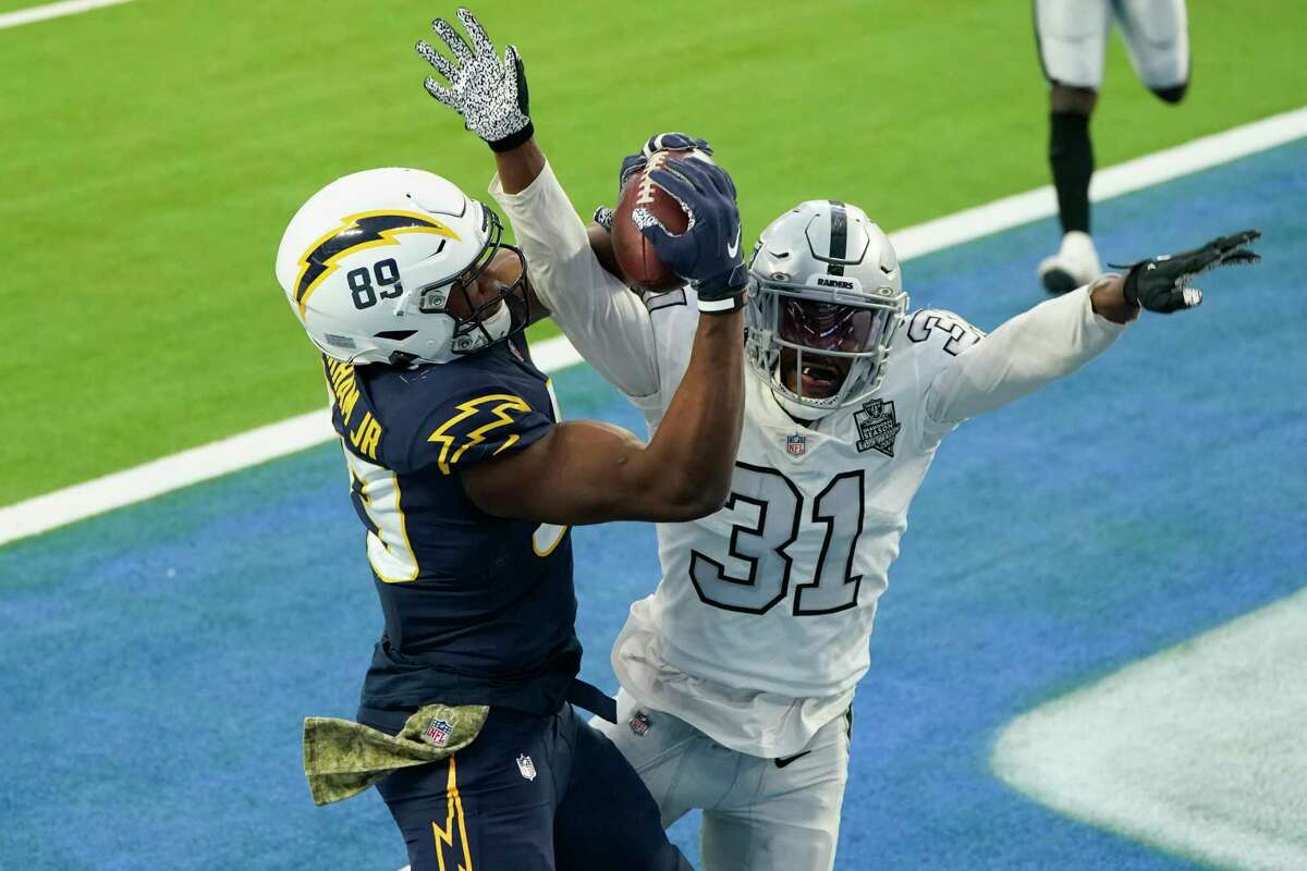 Raiders cornerback Isaiah Johnson defends Chargers tight end Donald Parham on the final play of Sunday's game to seal Las Vegas' win.