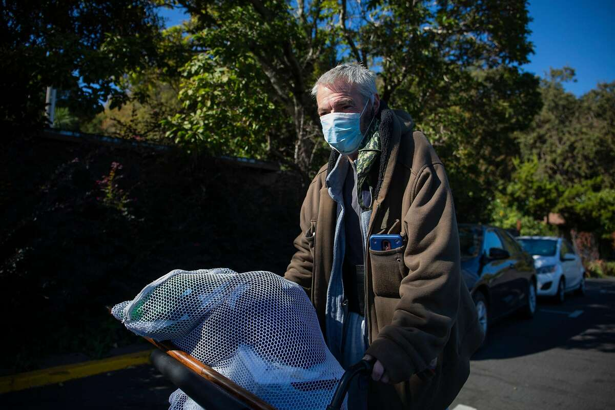 Richard Hoyt, walking near the Inn Marin Hotel in Novato, says he has applied for housing for nine years in Marin County but remains homeless.