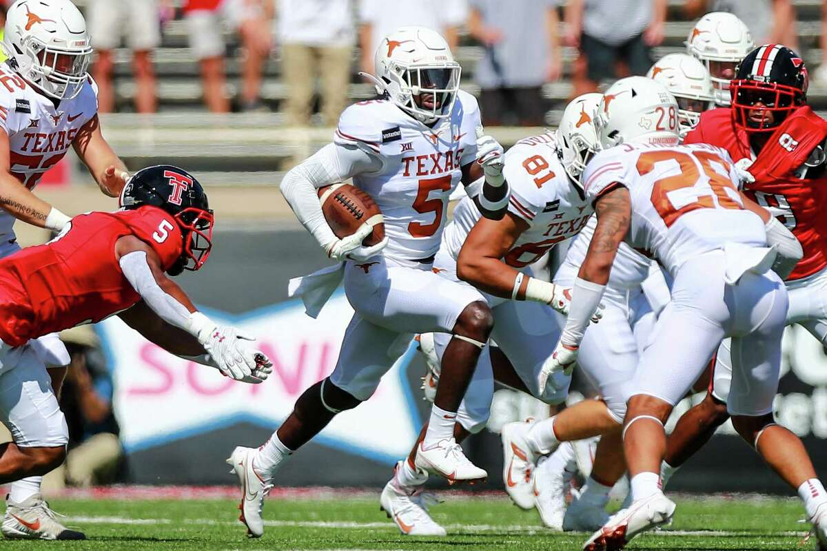 True freshman running back Bijan Robinson is still growing into a bigger role for Texas, but at 6 feet, 222 pounds he is proving to be ready for the physical demands of major college football.