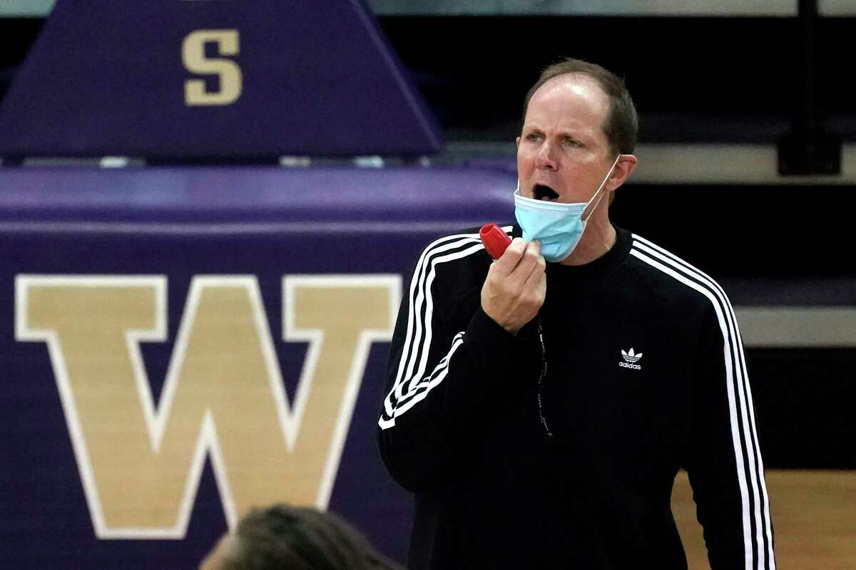 Washington head coach Mike Hopkins directs his team during an NCAA college basketball practice Tuesday, Oct. 27, 2020, in Seattle. The first two seasons went nearly perfect for Hopkins. A season of taking over and building a foundation and trust was followed by a season where it all meshed into a Pac-12 regular season title and a return to the NCAA tournament. But in year three, the Huskies finished last in the conference and with a below .500 record.