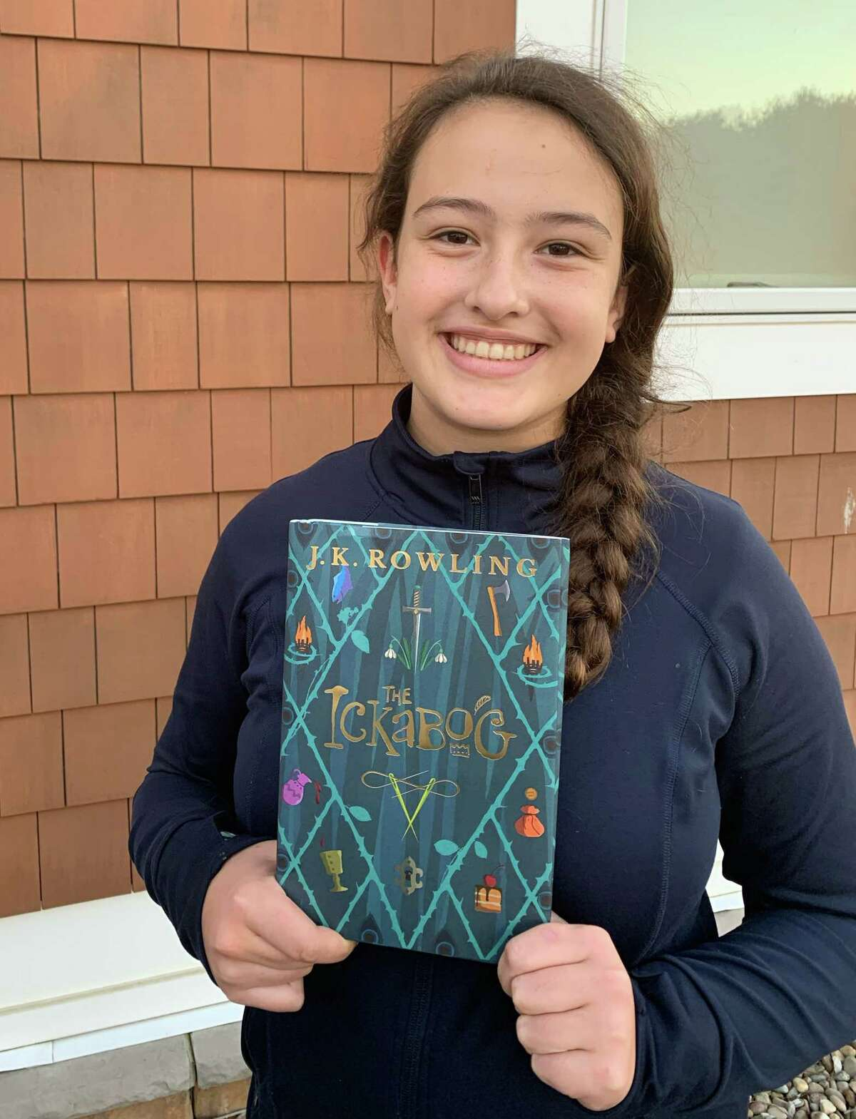 Isla Besha, 12, of Altamont holds a signed copy of J.K. Rowling?•s new book ?'The Ickabog.?