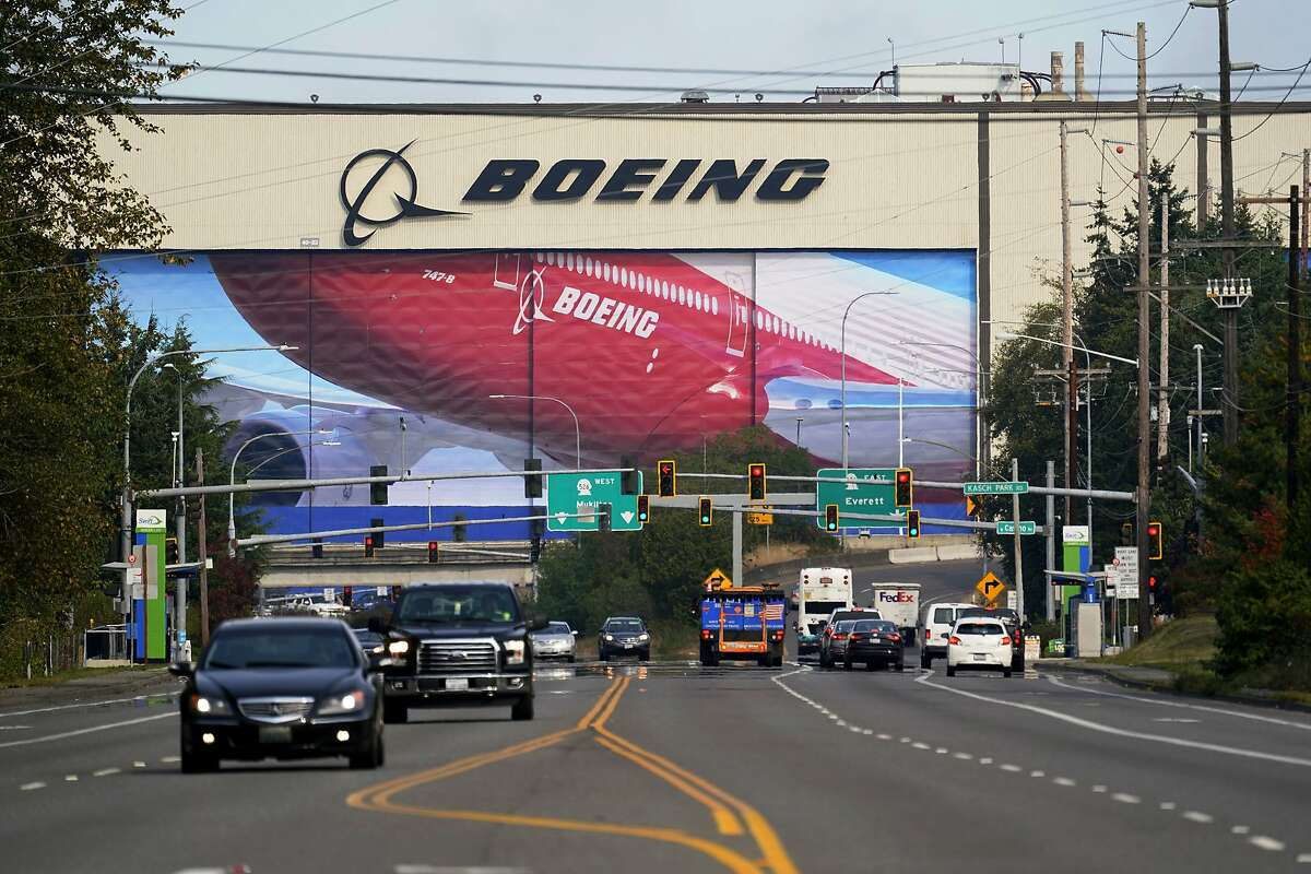 FILE - In this Oct. 1, 2020 file photo, traffic passes the Boeing airplane production plant, in Everett, Wash. (AP Photo/Elaine Thompson, file)