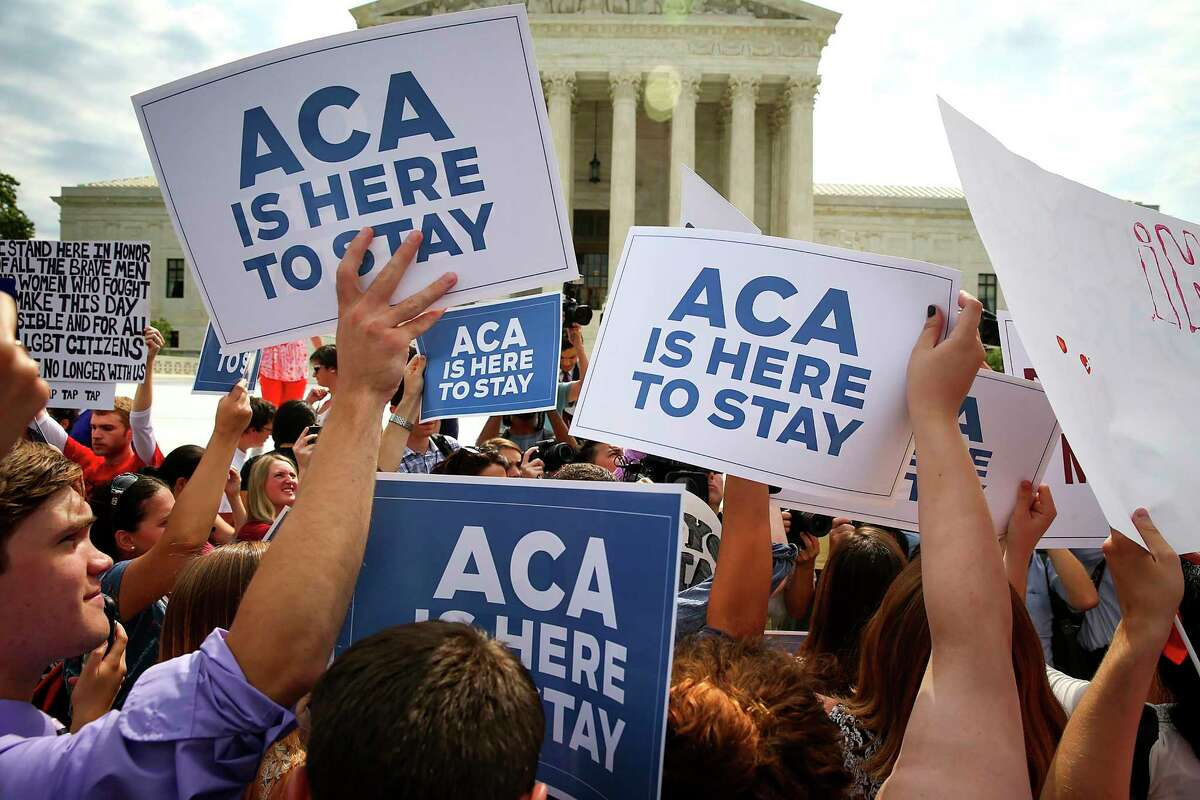FILE -- Supporters of the Affordable Care Act outside the Supreme Court in Washington, June 25, 2015. Eight years ago, the Affordable Care Act barely survived its first encounter with the Supreme Court - on Nov. 10, 2020, a significantly more conservative court will hear arguments in a case brought by Republican state officials, backed by the Trump administration, seeking to destroy it. (Doug Mills/The New York Times)