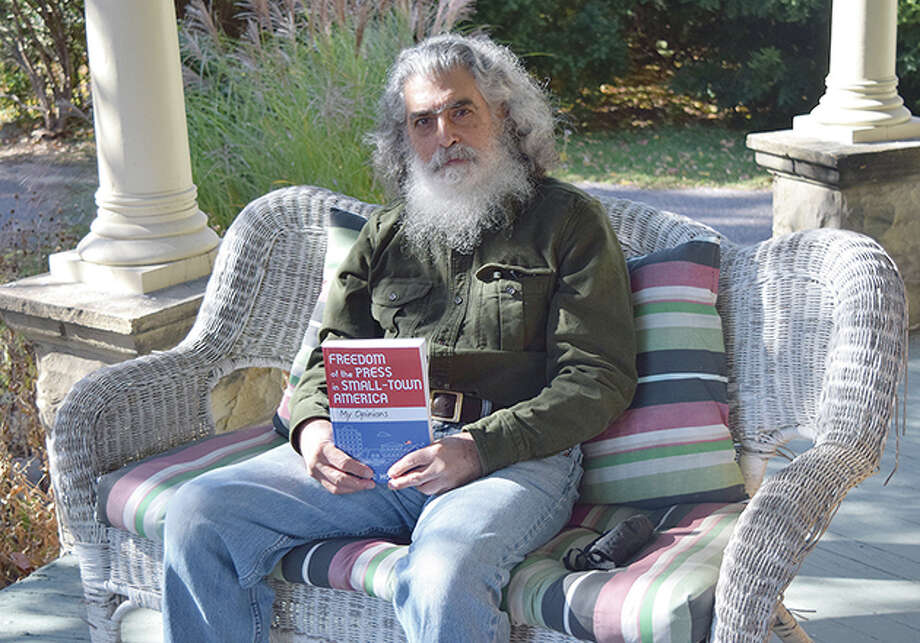"""Historian and writer Steve Hochstadt sits at home, holding his new book, """"Freedom of the Press in Small-Town America: My Opinions."""" It is now available at Our Town Books in Jacksonville and through Amazon.com. Photo: Rochelle Eiselt   Journal-Courier"""