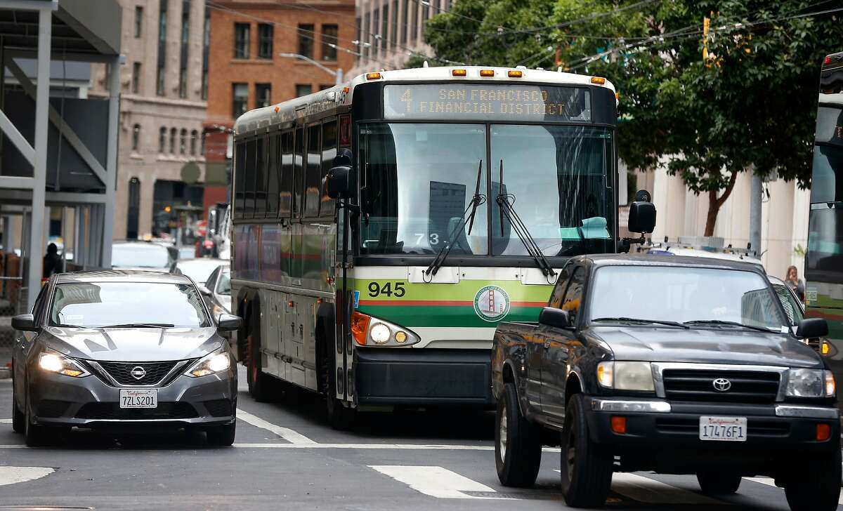 A Golden Gate Transit bus travels on First Street towards the Transbay Transit Center in San Francisco, Calif. on Friday, Sept. 27, 2019. The Golden Gate Bridge, Highway and Transportation District must cut a quarter of its positions, raise tolls on drivers coming from Marin to San Francisco or a combination of both to keep the agency afloat.