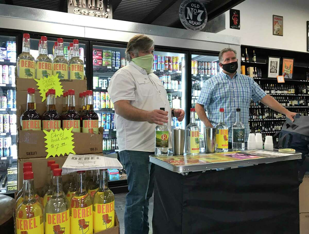 Chris Ware (left) and West Stone offer tastings of their Ranch Vodka during a recent event at Alamo City Liquor.