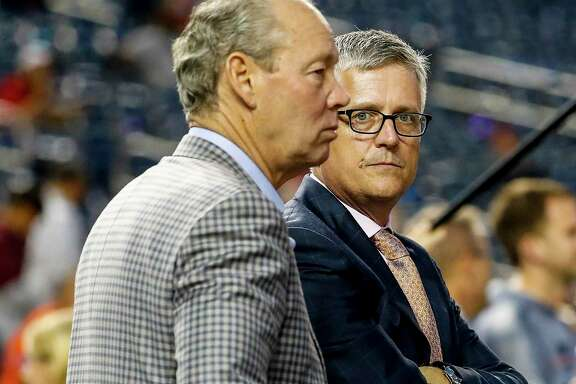 In a lawsuit filed Monday, former Astros general manager Jeff Luhnow, right, alleges that his firing by team owner Jim Crane denied him benefits that include $22 million of his $31 million contract plus bonuses and a guaranteed slice of the ballclub's profits.