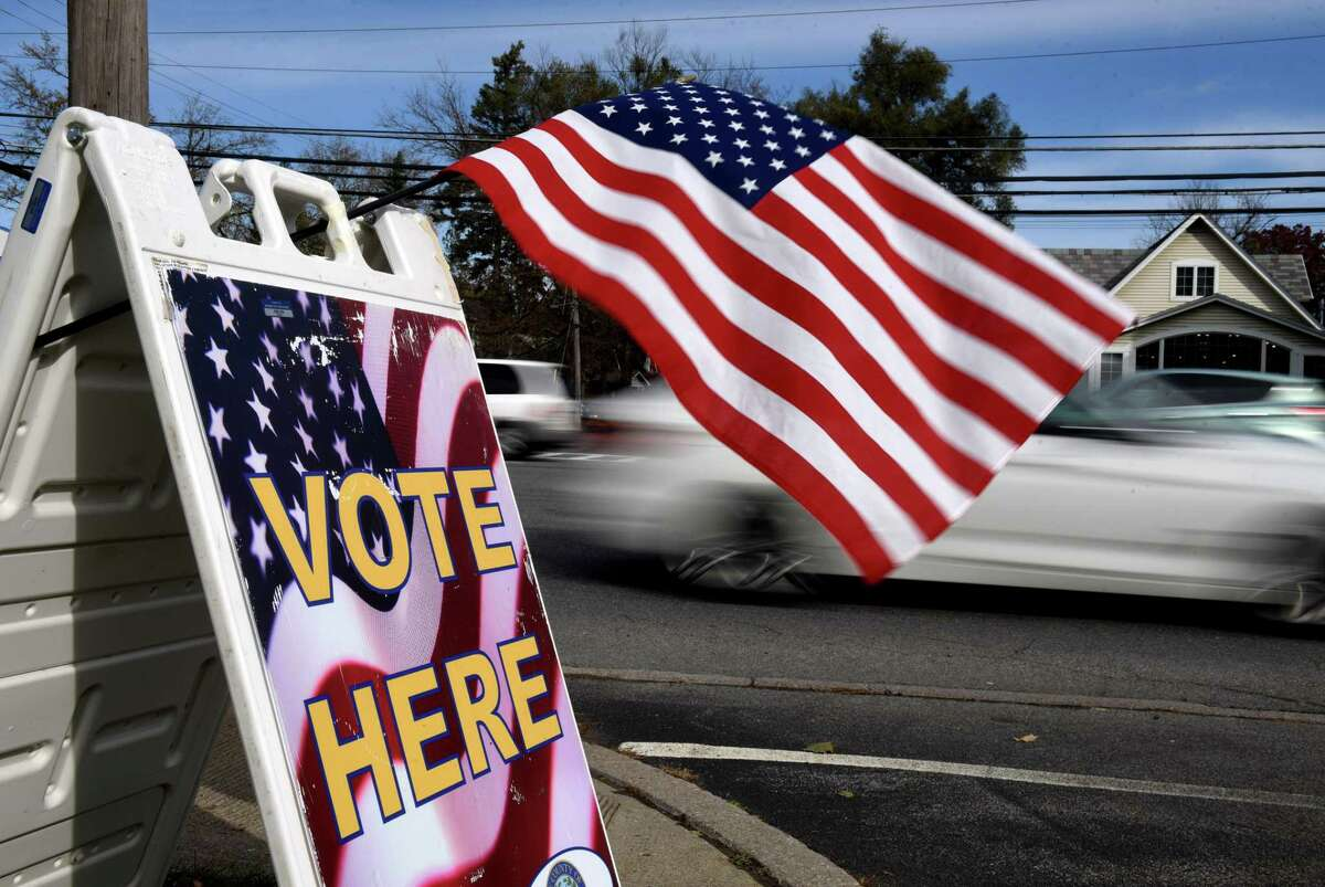 A flag on Central Avenue helps to alert passing motorists to the polling station at Pine Grove United Methodist Church in Colonie on Tuesday, Nov. 3, 2020. (Will Waldron/Times Union)