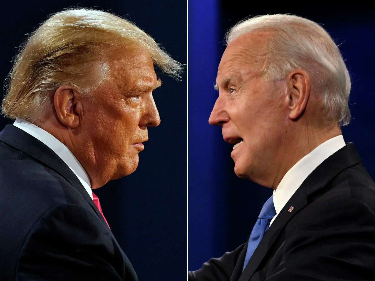(FILES)(COMBO) This combination of file pictures created on October 22, 2020 shows US President Donald Trump (L) and former Democratic Presidential candidate and former US Vice President Joe Biden during the final presidential debate at Belmont University in Nashville, Tennessee, on October 22, 2020. - President Donald Trump was still refusing to concede his election loss on November 9, 2020, but Democrat Joe Biden plowed ahead anyway with the first meeting of a parallel coronavirus task force, initiating an awkward and potentially volatile transition period. Traditionally, Trump would by now not only have accepted the results of Tuesday's election but started assisting the incoming administration before the January 20 handover. Construction has already begun along Pennsylvania Avenue for the ceremonies.However, the next weeks threaten to push the United States into unprecedented new tension after the already bitter election. (Photos by Morry GASH and JIM WATSON / AFP) (Photo by MORRY GASH,JIM WATSON/AFP via Getty Images)