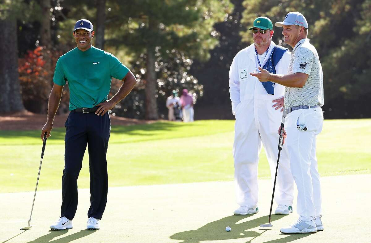 AUGUSTA, GEORGIA - NOVEMBER 09: Bryson DeChambeau of the United States and Tiger Woods of the United States talk on the 18th green during a practice round prior to the Masters at Augusta National Golf Club on November 09, 2020 in Augusta, Georgia. (Photo by Jamie Squire/Getty Images)