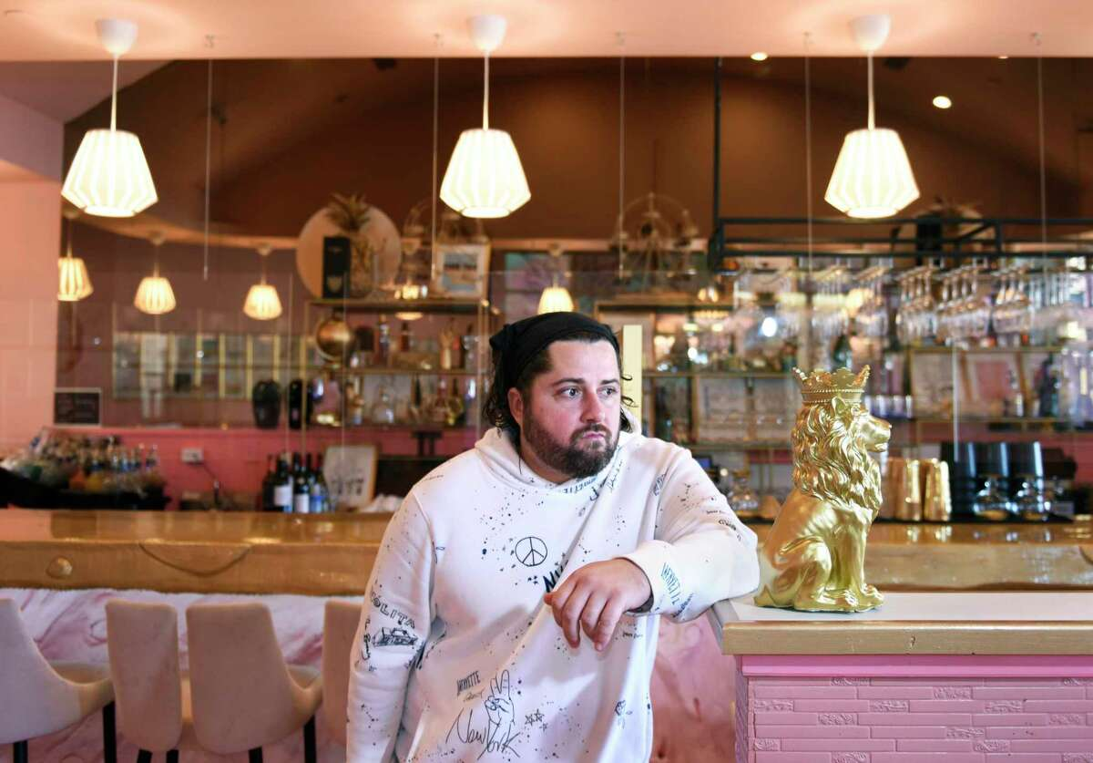 Co-owner John Nealon poses in his restaurant, The Lila Rose, in Stamford, Conn. Monday, Nov. 9, 2020. Nealon is unhappy about the rollback of coronavirus regulations to an amended version of Phase 2, being dubbed Phase 2.1, which includes a mandatory 10 p.m. closing time.