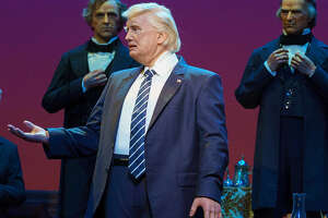 Donald Trump has drawn both cheers and boos in his featured role in Disney's Hall of Presidents.