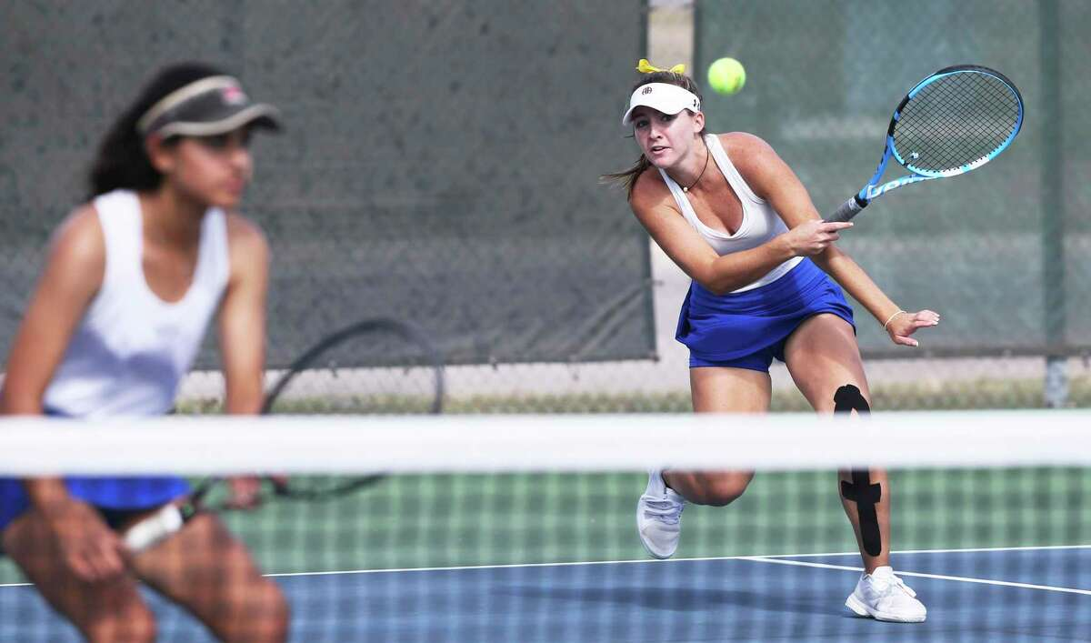 Brianna Wilbur volleys for the Mules in doubles as Alamo Heights plays Boerne Champion in Region IV-5A tennis on Nov. 9, 2020.