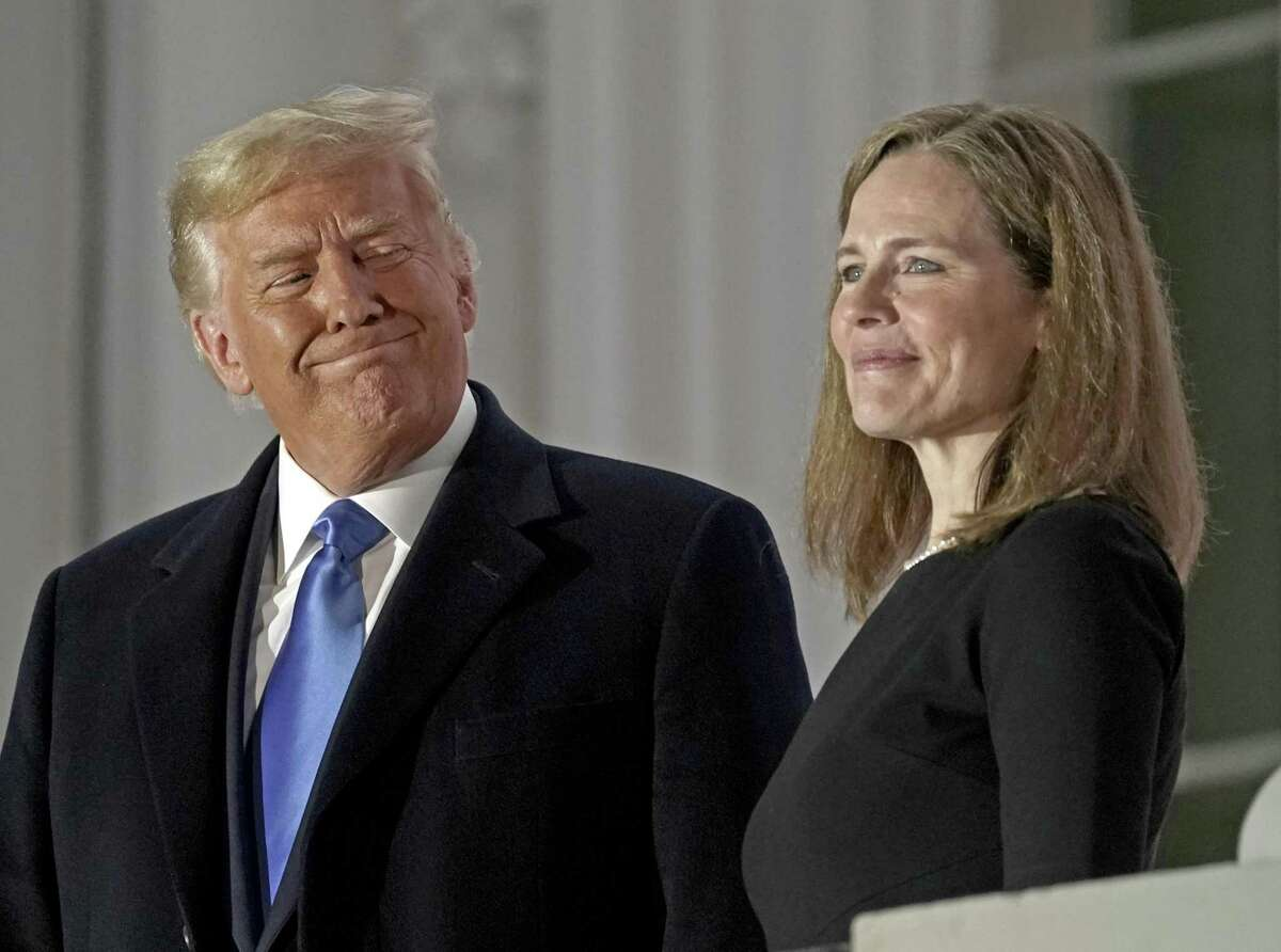 FILE: Bloomberg Best Of U.S. President Donald Trump 2017 - 2020: U.S. President Donald Trump, left, and Amy Coney Barrett, associate justice of the U.S. Supreme Court, stand on a balcony during a ceremony on the South Lawn of the White House in Washington, D.C., U.S., on Monday, Oct. 26, 2020. Our editors select the best archive images looking back at Trump's 4 year term from 2017 - 2020. Photographer: Ken Cedeno/CNP/Bloomberg