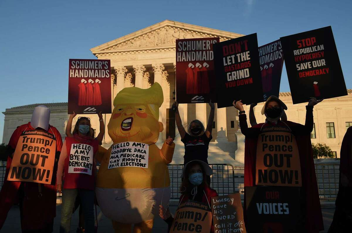 TOPSHOT - Opponents of US Supreme Court nominee Amy Coney Barrett dressed in costumes inspired of
