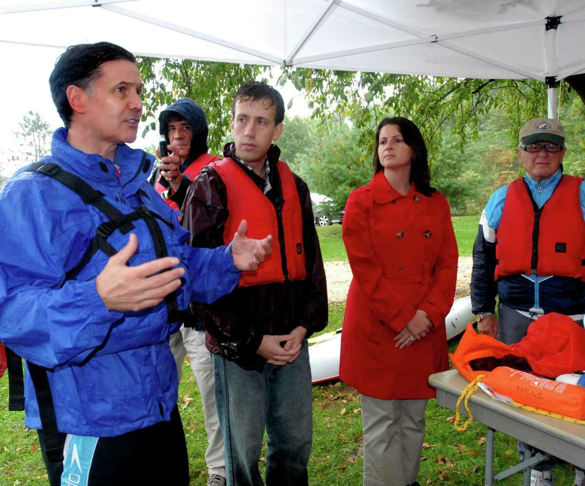 CROMWELL-DEP Commissioner Dan Esty leads an afternoon of exploring the resources of the Connecticut and Mattabesset Rivers. Dan Esty (L) talks before the group sets out from Cromwell. With him L to R are State Reps. Matthew Lesser, and Christie Carpino, and State Sen. joe Crisco. Melanie Stengel/Register