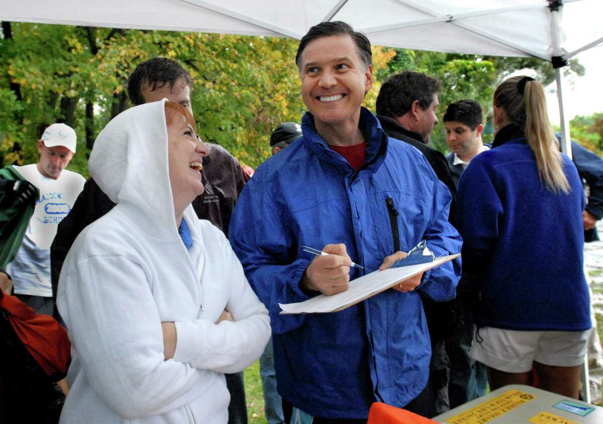 CROMWELL-DEP Commissioner Dan Esty leads an afternoon of exploring the resources of the Connecticut and Mattabesset Rivers. Traci DeVore of the DEP Boating Divgision (L) laughs with Commissioner Esty as he signs in for the Rivers exploration trip. Melanie Stengel/Register