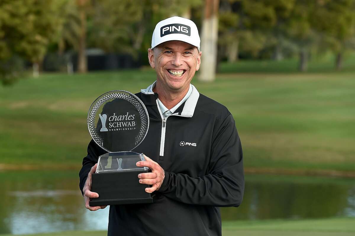 PHOENIX, ARIZONA - NOVEMBER 09: Kevin Sutherland poses with the trophy after winning the Charles Schwab Cup Championship in a nine-hole playoff at the Phoenix Country Club on November 09, 2020 in Phoenix, Arizona. (Photo by Steve Dykes/Getty Images)