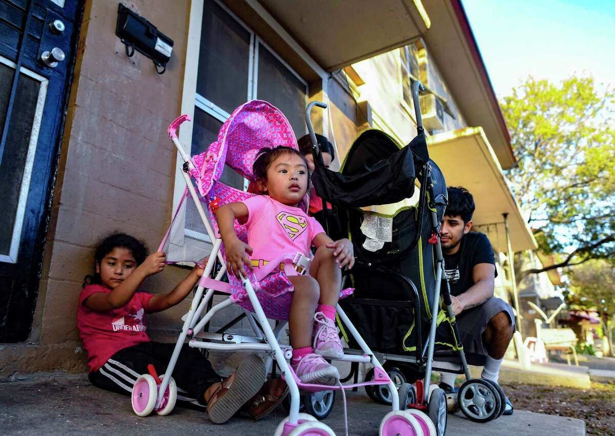 Zalaylah Delgado, front, and Jazzlyn Herrera play at the Alazan Courts, San Antonio's first public housing complex, on Monday, Nov. 9, 2020. The complex was built in 1939 and people, mostly Mexican-Americans, began to move in during 1940.