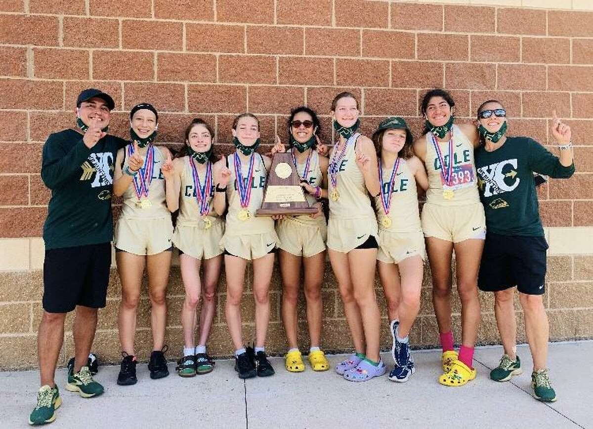 Members of Cole's girls cross country team pose with the Region IV-3A championship trophy they won on Monday, Nov. 9, 2020 at Texas A&M-CorpusChristi.