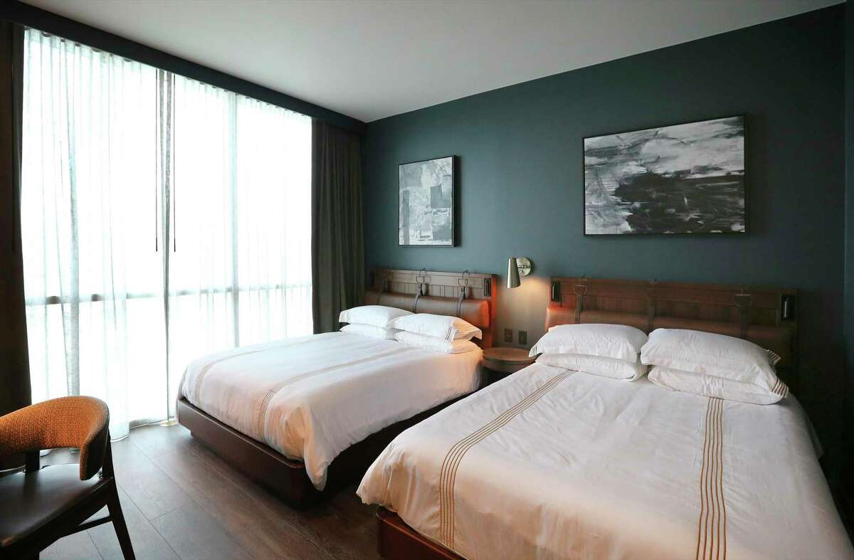 One of 162 guest rooms shows off its trappings. The hotel building also houses 59 condominiums.