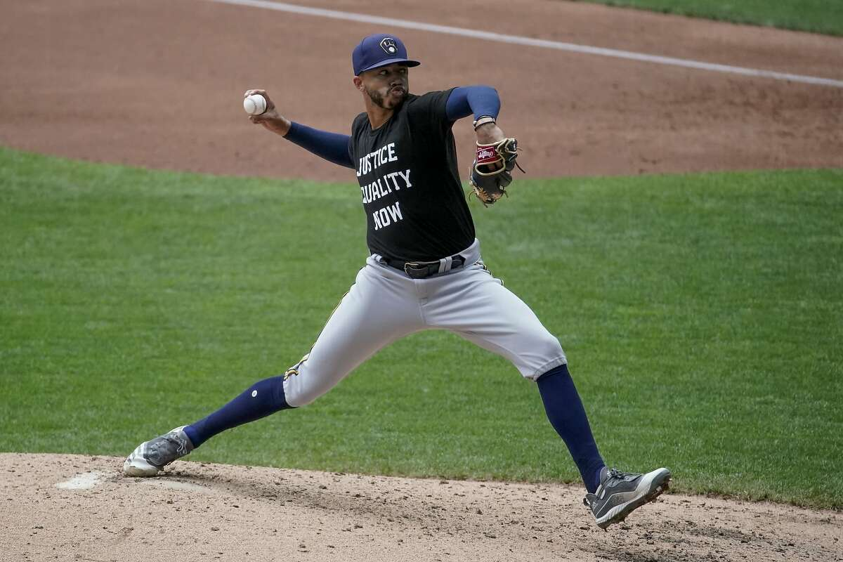 FILE - Milwaukee Brewers' Devin Williams throws during an intrasquad game at Miller Park in Milwaukee, in this Tuesday, July 21, 2020, file photo. Williams won the NL Rookie of the Year award on Monday, Nov. 9, 2020. (AP Photo/Morry Gash, File)