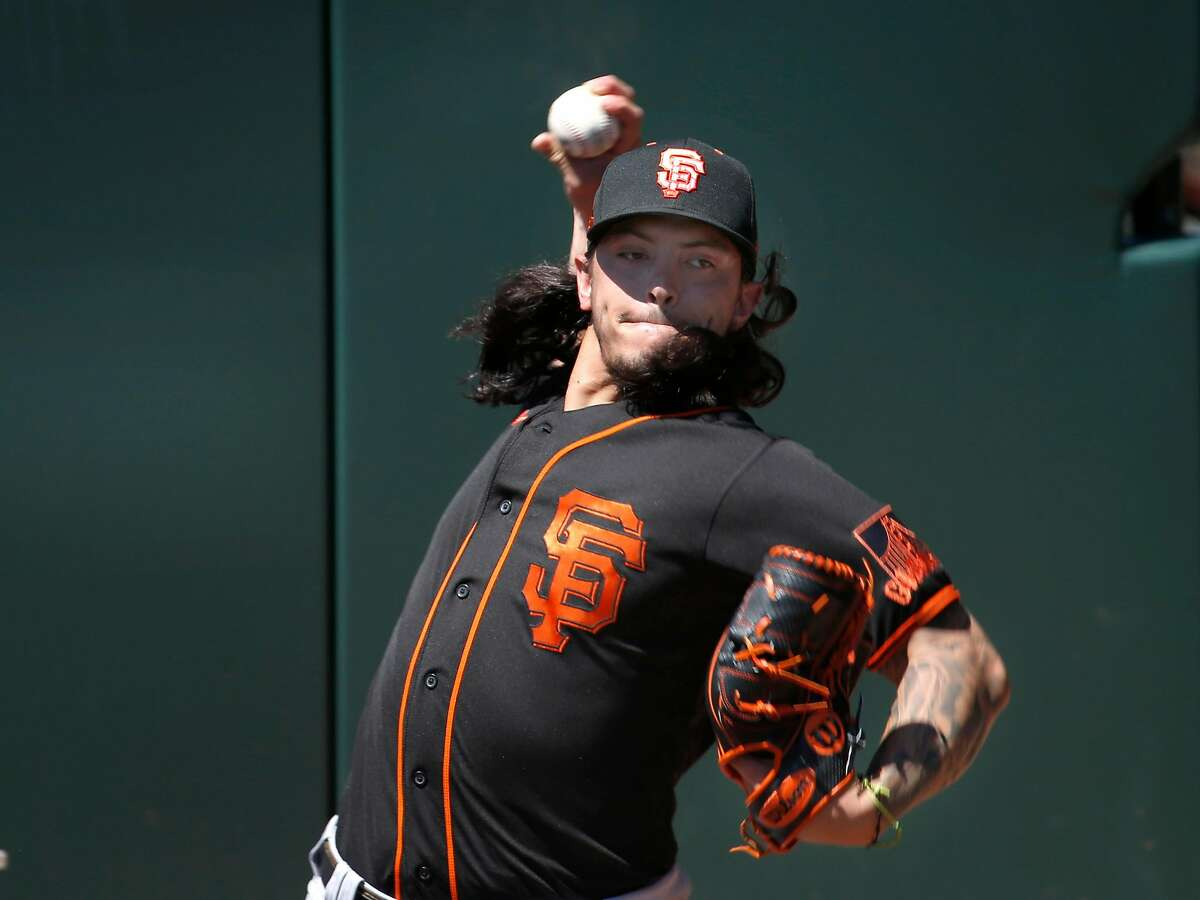 Dereck Rodriguez warms up in the bullpen during the Giants summer training camp at Oracle Park in San Francisco, Calif. on Thursday, July 9, 2020.