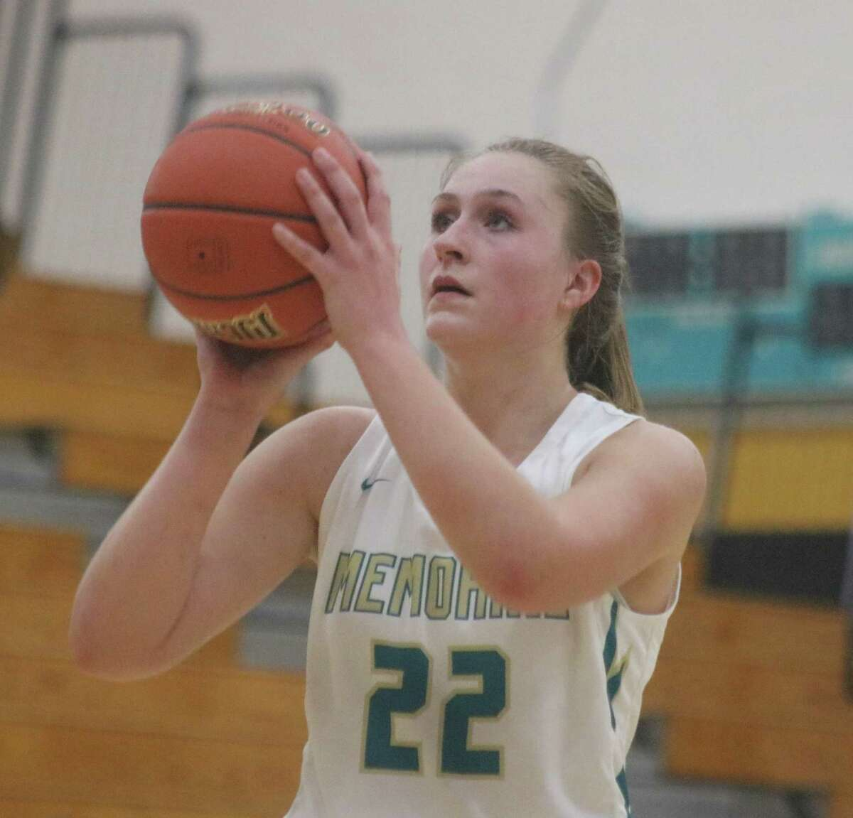 Aubree Casteel tries to draw Memorial closer Monday night with a foul shot attempt. Casteel finished with a double-double, securing six defensive rebounds just in the fourth period.