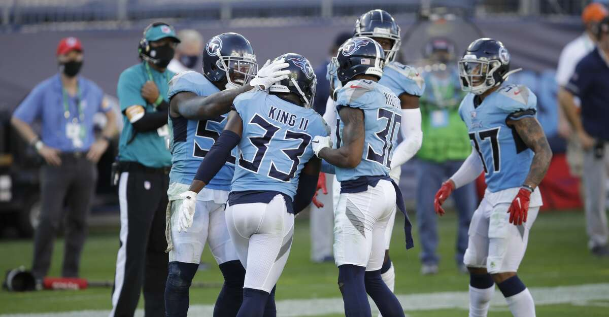 Tennessee Titans cornerback Desmond King (33) is congratulated by teammates after he returned a fumble recovery 63 yards for a touchdown against the Chicago Bears in the second half of an NFL football game Sunday, Nov. 8, 2020, in Nashville, Tenn. (AP Photo/Ben Margot)