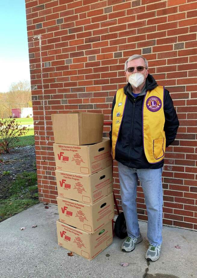 The New Milford Lions Club continues to support the community during the pandemic. The club recently delivered 70 boxes of produce, meat, cheese and other goods, along with 75 gallons of milk, to New Milford Social Services. Five boxes of items were also delivered to Loaves and Fishes Hospitality House. Above, Lion President John Dunne makes the delivery. Photo: Courtesy Of New Milford Lions Club / Danbury News Times Contributed