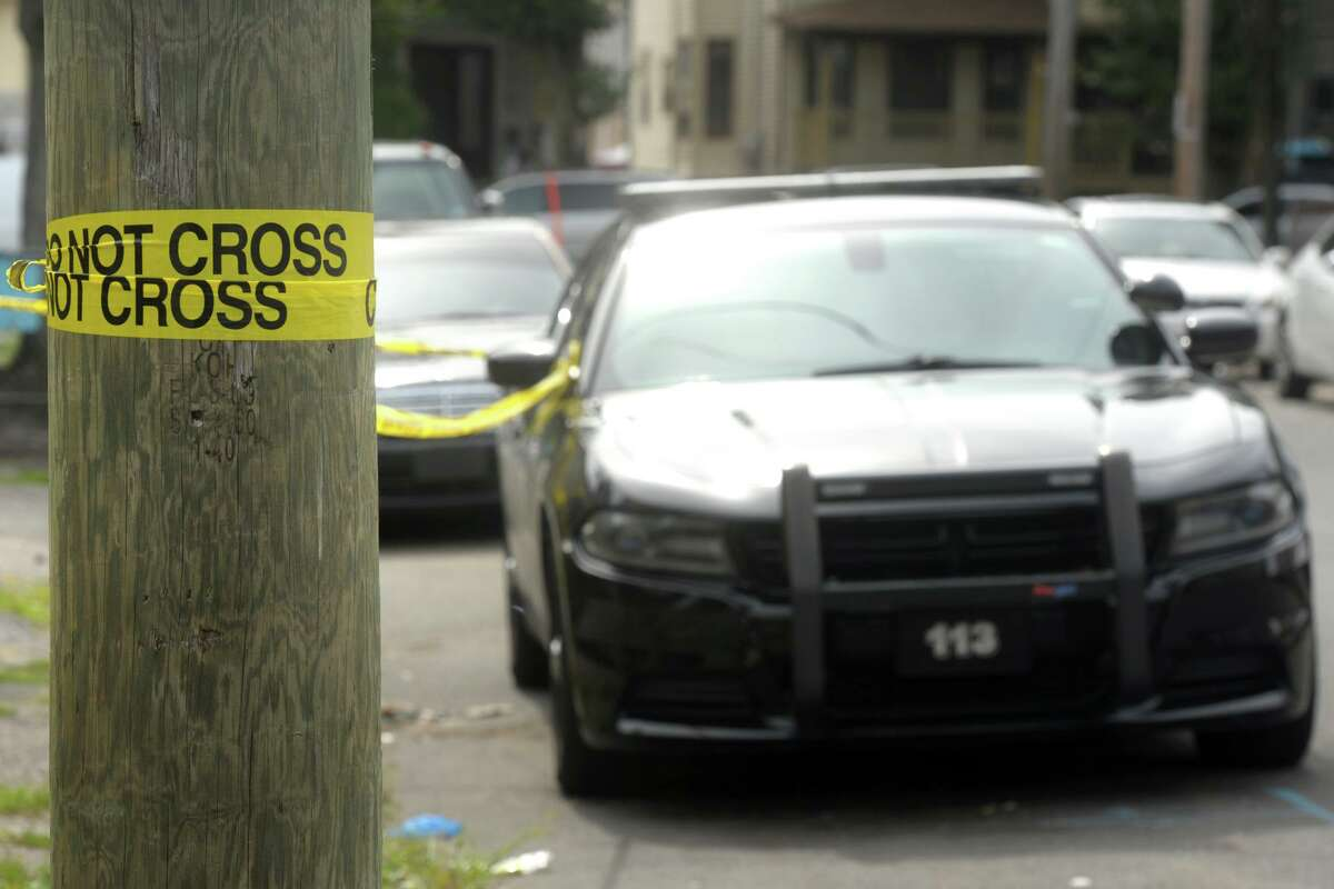 A file photo of police cruisers at a crime scene in Bridgeport, Conn.