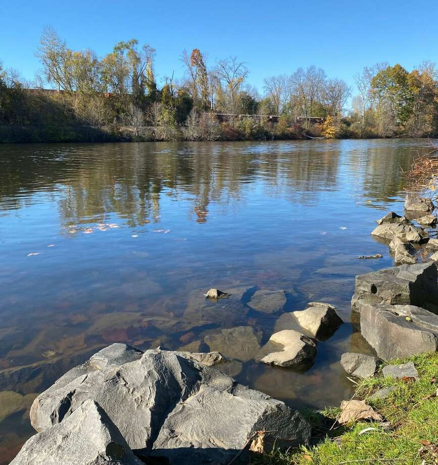 The Housatonic River, above, flows alongside Addis Park on Grove Street. Photo: Deborah Rose /Hearst Connecticut Media / Danbury News Times