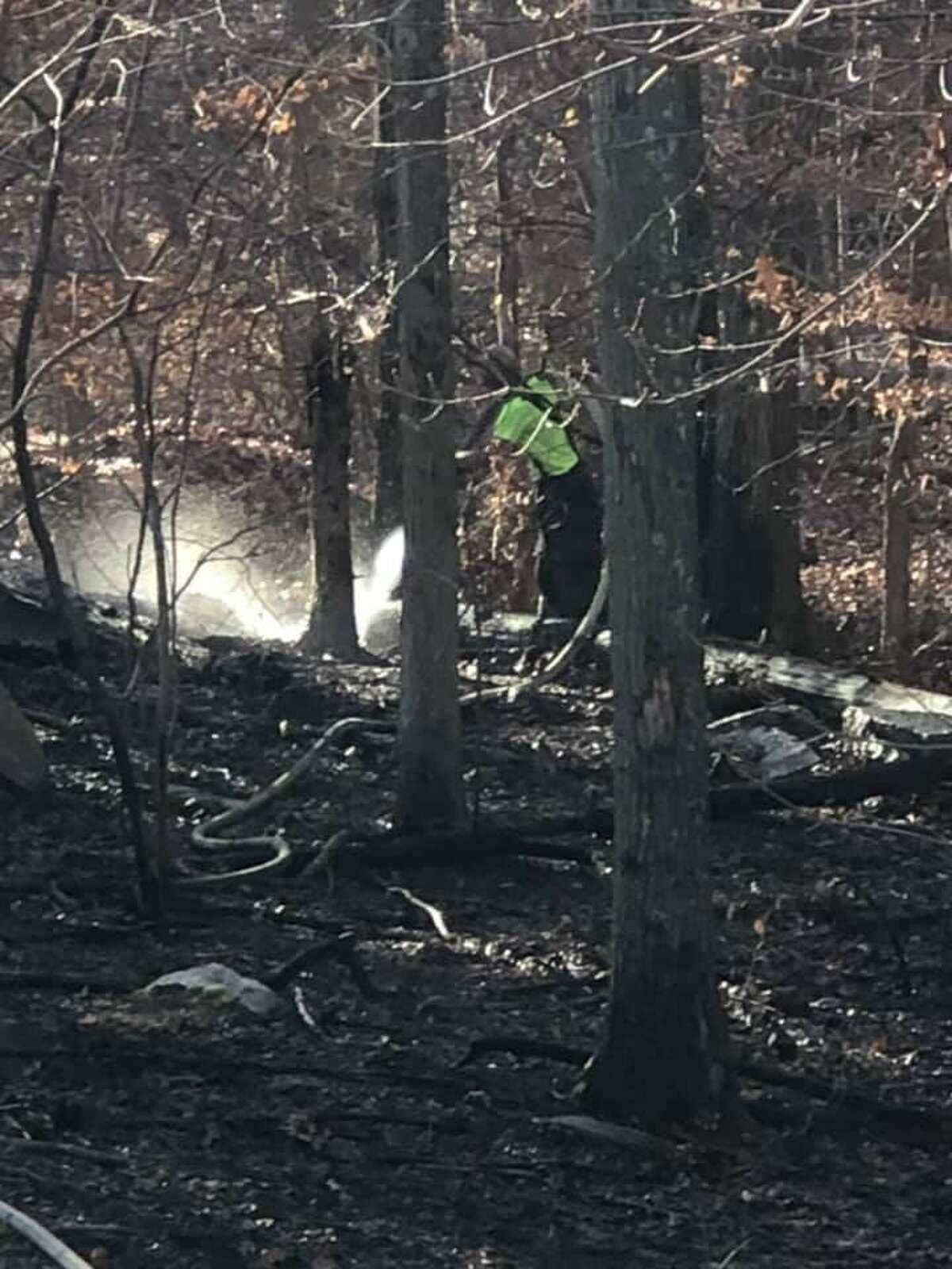 Fire crews on scene for a brush fire in Monroe, Conn., on Monday, Nov. 9, 2020.
