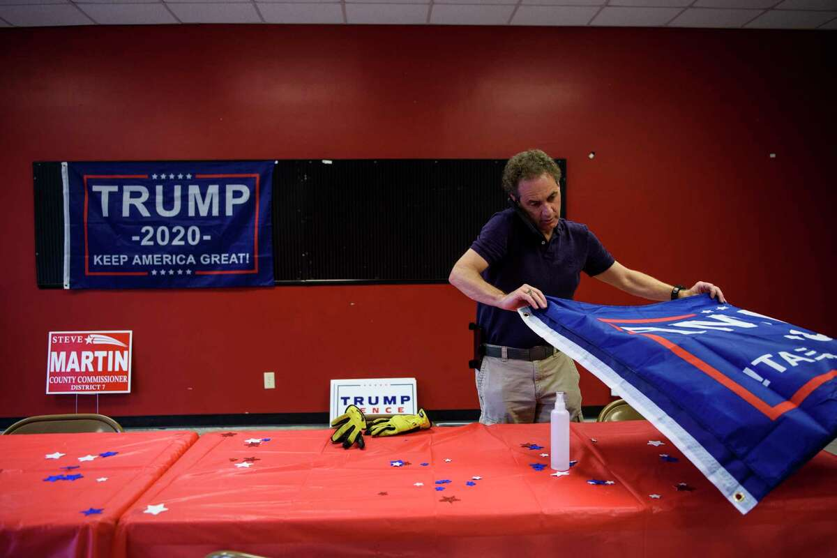 Phillip Stephens, head of the Robeson County GOP, takes down signage while packing up material at the local GOP headquarters in Lumberton, N.C.