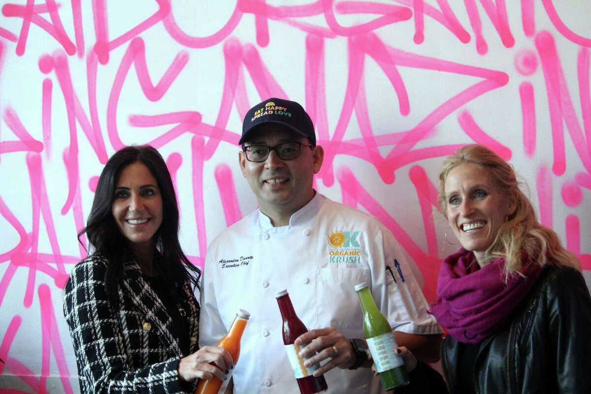 Organic Krush co-owner Fran Paniccia, left, Executive Chef Alejandro Duarte, middle, and Organic Krush co-owner Michelle Walrath. Taken Nov. 2, 2020 in Westport, Conn. Michelle Walrath and Fran Paniccia, co-owners of Organic Krush, first started the business six years ago after the two had trouble finding a healthy eatery while traveling on the road with their kids.