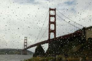 In this file photo, the Golden Gate Bridge is visible through rain drops on a car window at Fort Baker in Sausalito, California.