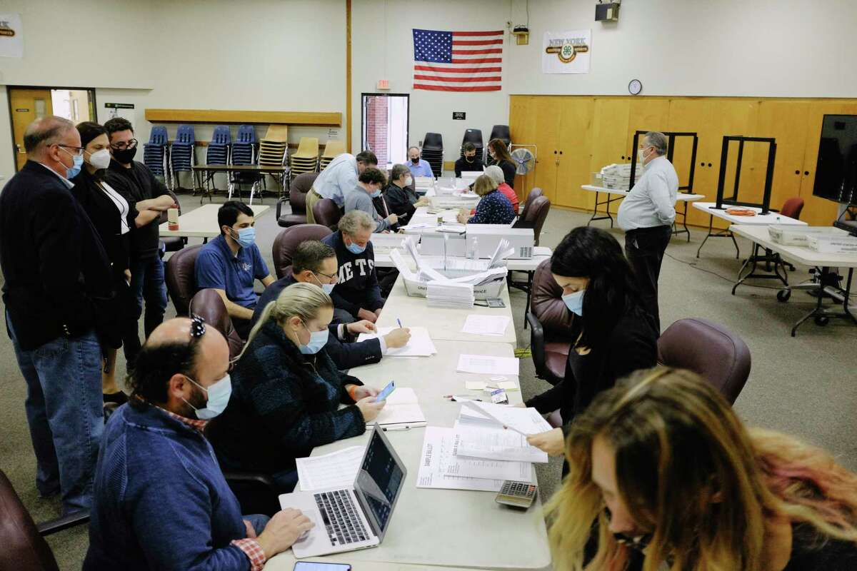 Saratoga County Board of Elections workers begin the process of counting absentee ballots on Tuesday, Nov. 10, 2020, in Ballston Spa, N.Y. (Paul Buckowski/Times Union)