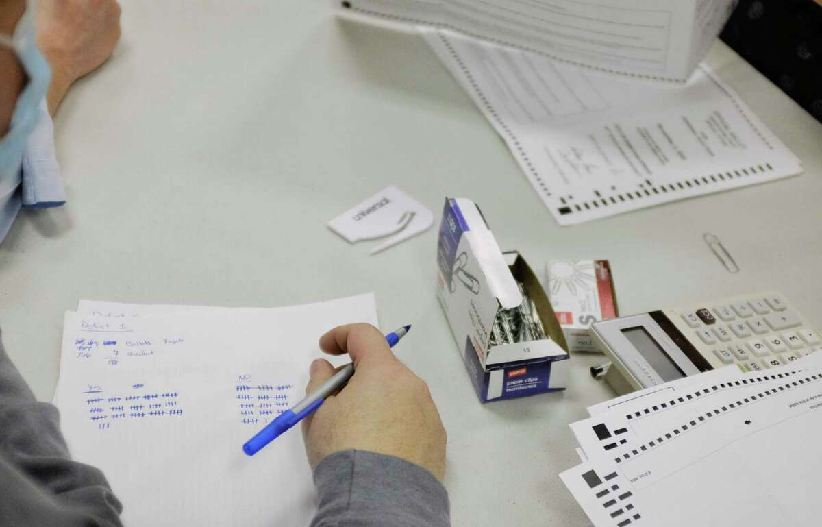 A member of the public keeps count of the votes for and against the City of Saratoga Springs charter vote referendum during the counting of absentee ballots on Tuesday, Nov. 10, 2020, in Ballston Spa, N.Y. (Paul Buckowski/Times Union)