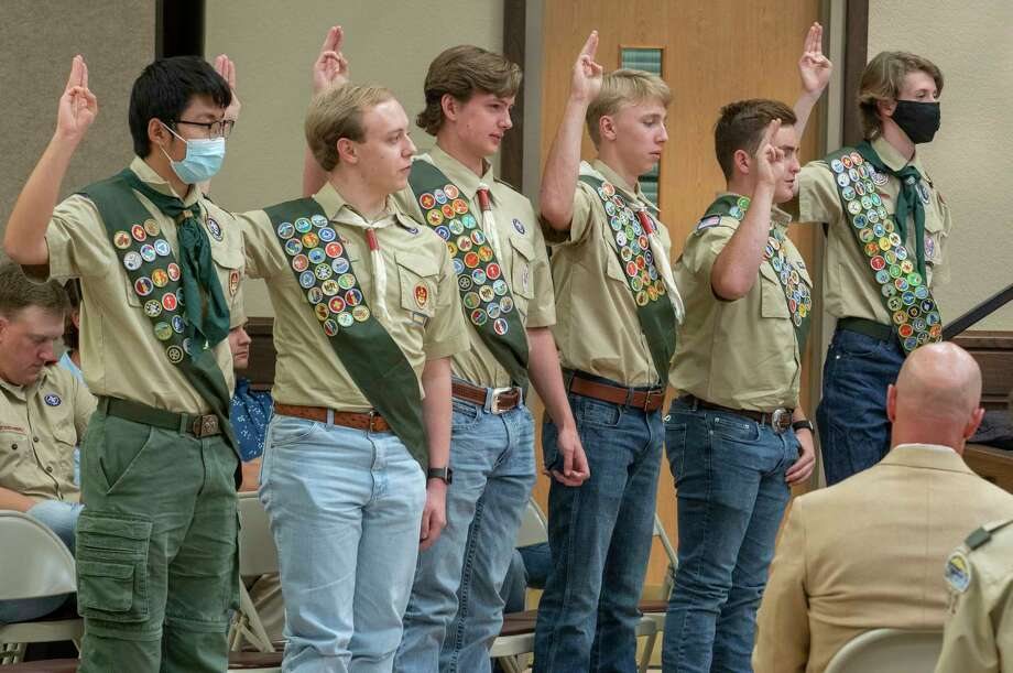 Scouts in Troop 232 raise their hand to recite their Eagle Scout Oath 11/09/2020 during a ceremony honoring the 6. From left, Jing Li, Leighton Petty, Kyle Cheatham, Andrew Strahan, Nathan Walker and Richard Werner earned their Eagle Badge. Tim Fischer/Reporter-Telegram Photo: Tim Fischer, Midland Reporter-Telegram