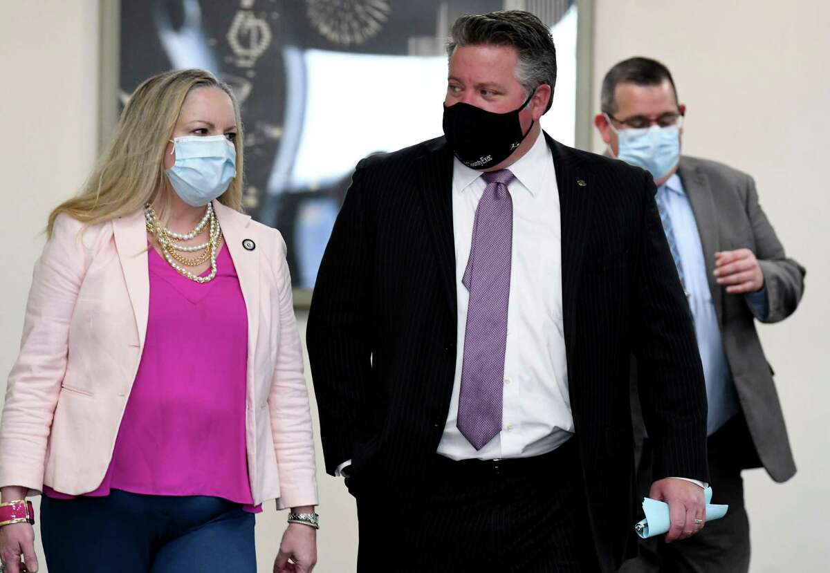Albany County Department of Health Commissioner Dr. Elizabeth Whalen, left, and and Albany County Executive Daniel P. McCoy, center, enter the Cahill Room to deliver a coronavirus news briefing on Tuesday, Nov. 10, 2020, at the county offices in Albany, N.Y. (Will Waldron/Times Union)
