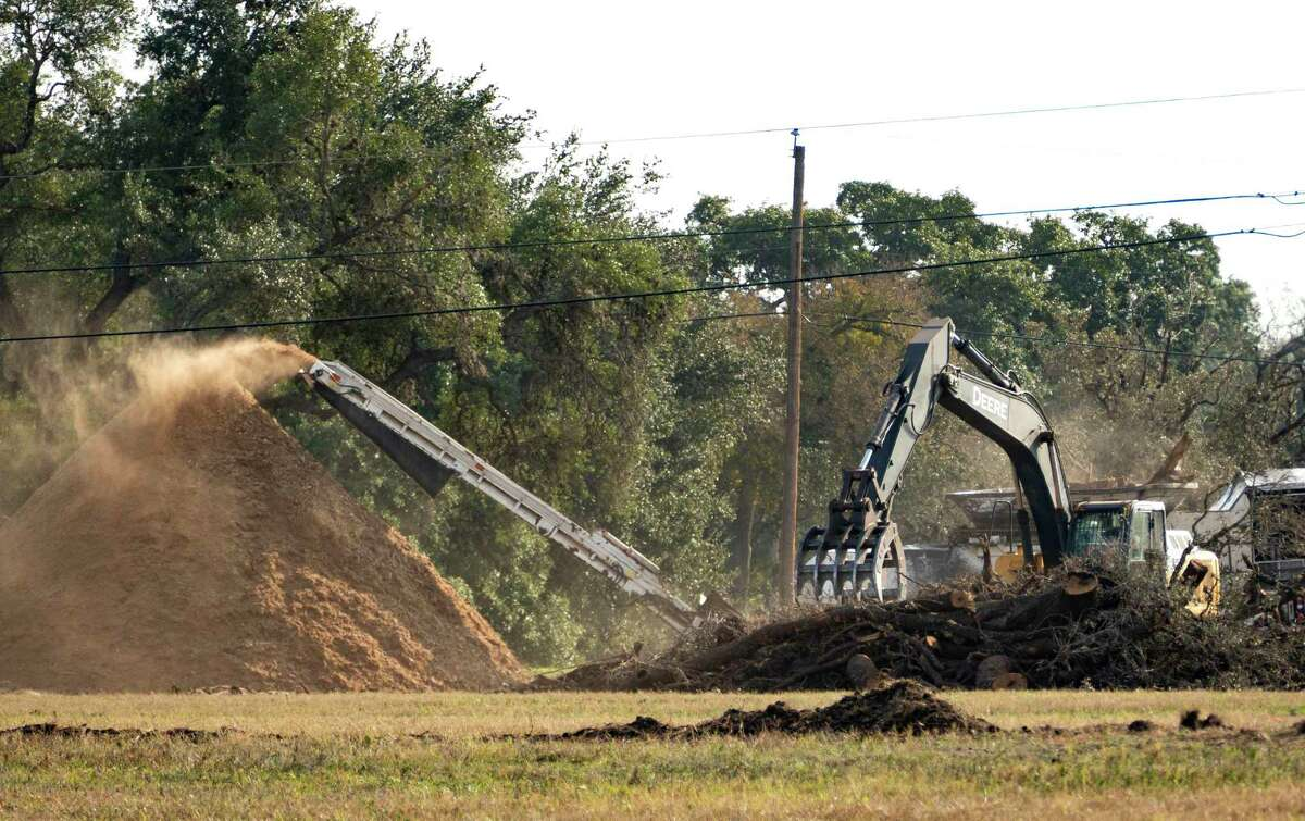 A tree chipper works in an area being cleared near JBSA-Randolph's southeast runway near Lower Seguin Road last December. The government-owned property is in one of the clear zones for aircraft at the end of the base's runways.