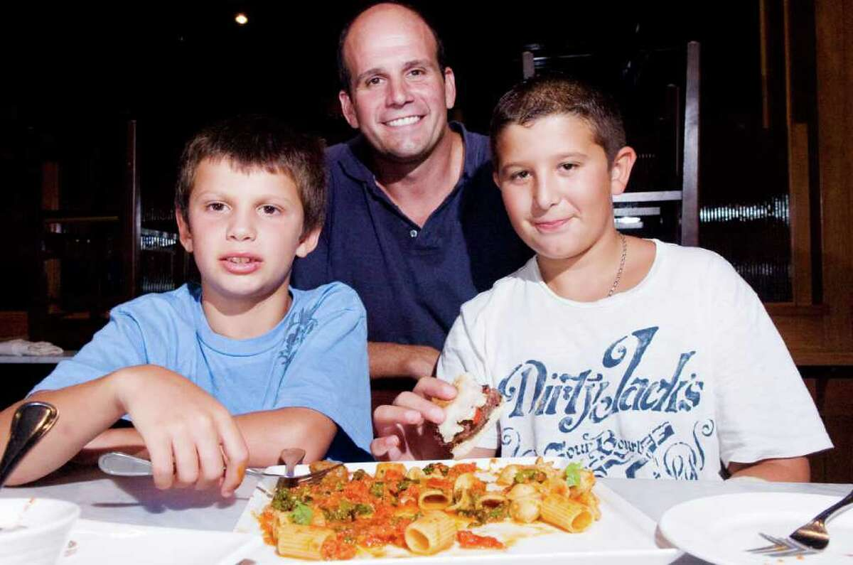Joe Rocco and his sons Lorenzo, 9, and Joey, 11, test dishes by chef Adam Truelove as they create a menu for the launch of The Pine Social at 36 Pine Street Wednesday, September 1, 2010. The spot was home to Rocco's Italian Kitchen but the Rocco family has decided to transform it into a new restaurant with a menu featuring more American dishes.