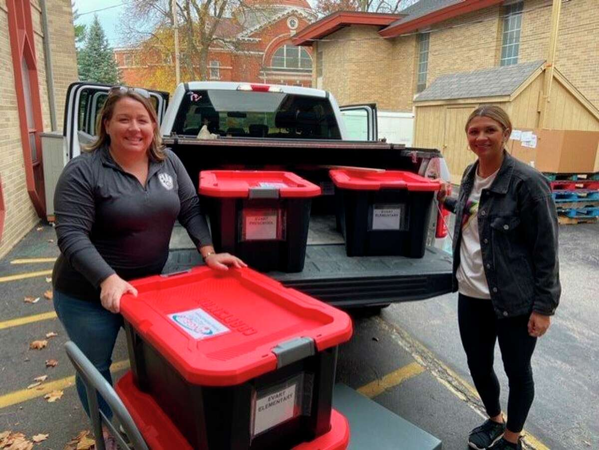 Volunteers with Angels of Action deliver food to Reed City and Evart schools. (Courtesy photo)