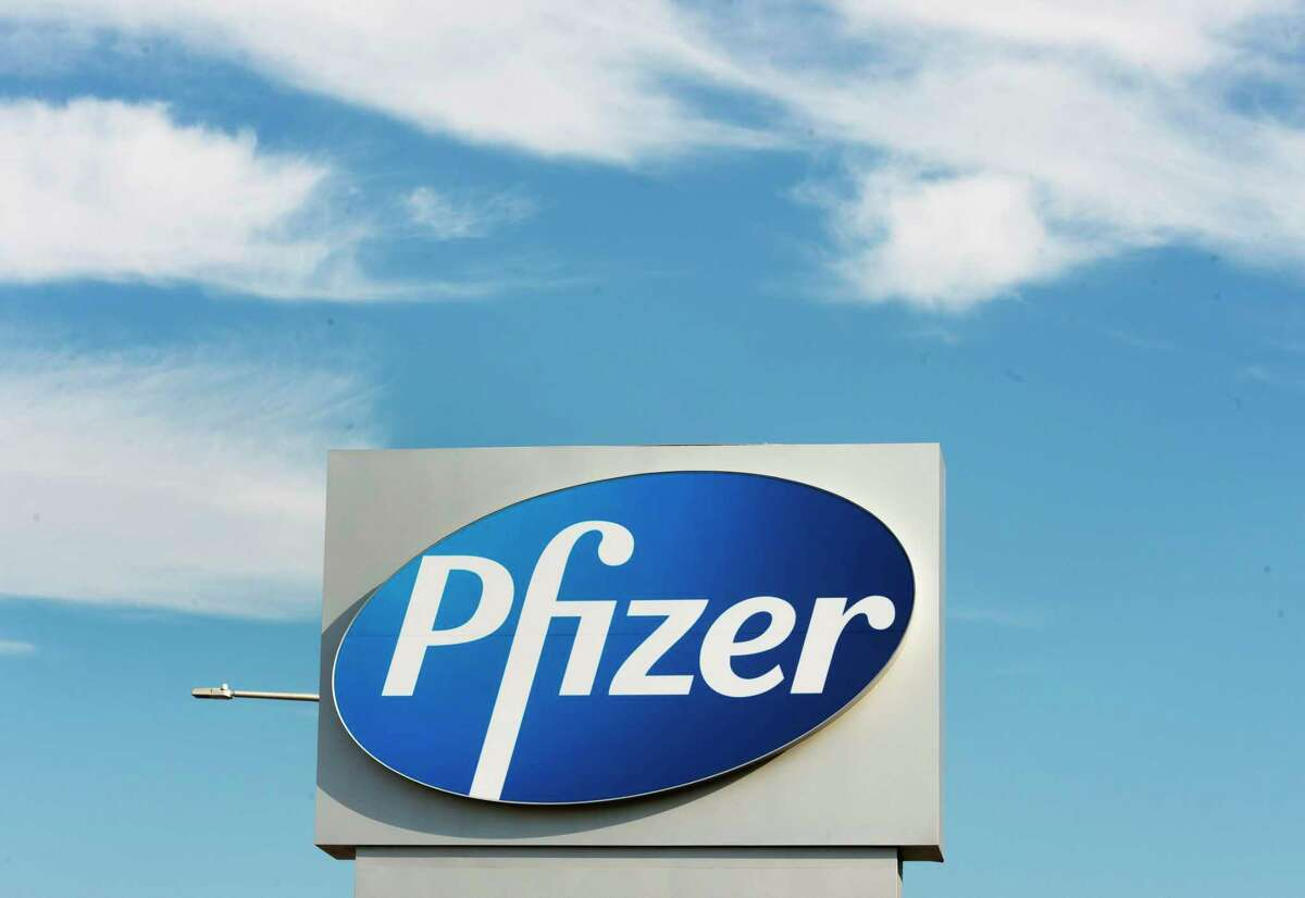 A sign with the Pfizer logo stands outside the corporate headquarters of Pfizer Canada in Montreal, on Monday, Nov. 9, 2020.