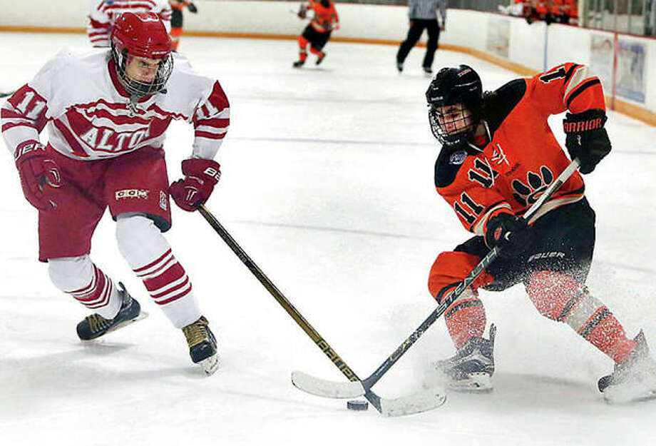 Players from Alton and Edwardsville fight for the puck during a game at the East Alton Ice Arena during a previous Mississippi Valley Club Hockey Association season. The league's season, already delayed, is in jeopardy because of hockey's Illinois Department of Public Health status as a high risk activity. Photo: Telegraph File Photo