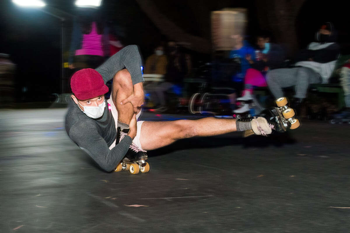 Jorge Bustos performs a roller skating trick called the