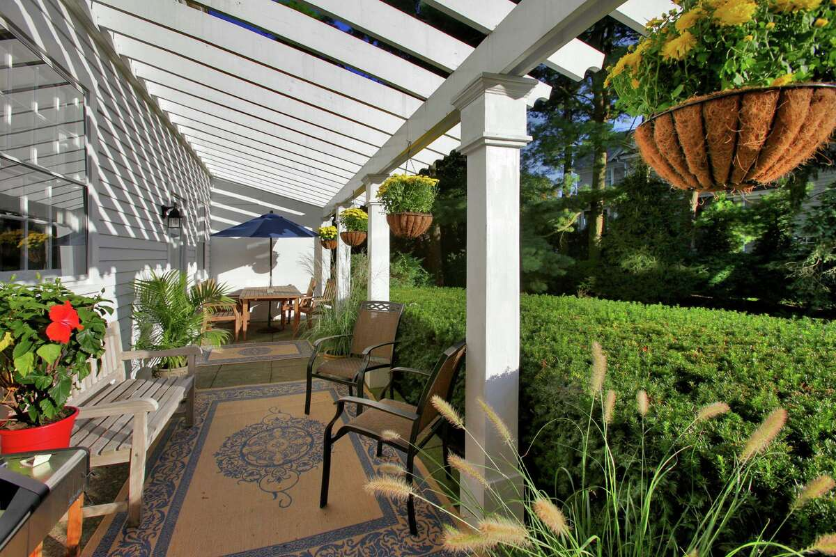 This property features a veranda with a pergola. Inside, the house features 11 rooms and 3,969 square feet of living space.