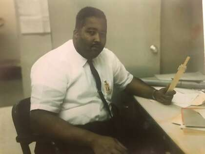 Jerry Lawson and his slide rule — the calculator before calculators — in the 1960s.