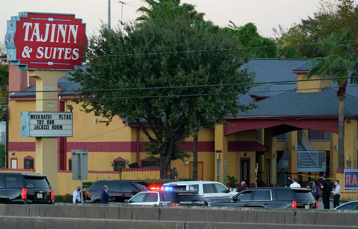 Police personnel and others are shown outside the Taj Inn and Suites, 7766 North Fwy., near where a Houston Police Dept. Sgt. Sean Rios was fatally shot Monday, Nov. 9, 2020 in Houston. Sgt. Rios, 47, a 25-year veteran with HPD, ran into the motel for help but he died in the lobby.